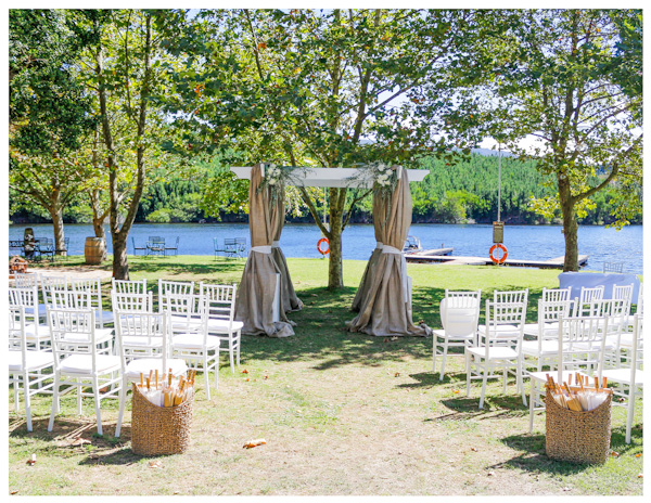 White wooden gazebo with burlap fabric