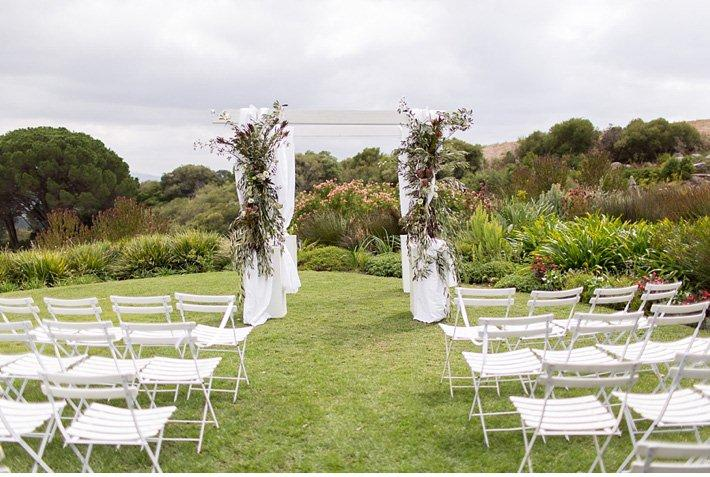 White wooden gazebo with fabric detail