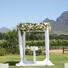 White fabric gazebo with floral roof
