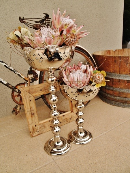 Adjustable silver vases tall to small.jpg