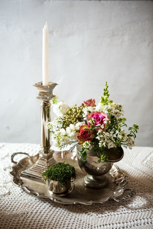 Variety of single silver candle sticks
